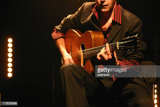 classical/acoustic guitarist on stage - classical guitar stock photos and pictures