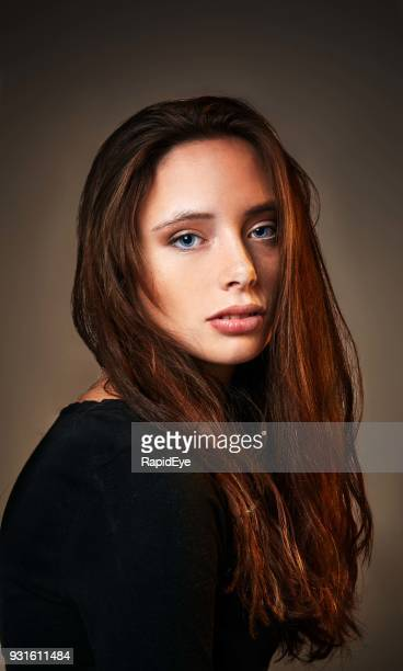 classically beautiful young brunette looking serene - long nose stock photos and pictures