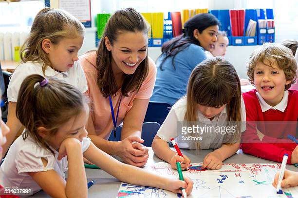 classmates drawing together - classroom stock photos and pictures