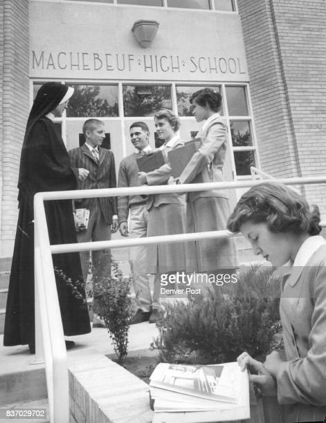 Classmates gather at the entrance of new Machebeuf High School with the principal Sister Mary Thomasine In front is Anita Howe of 1260 Pontiac St...