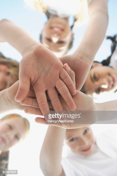 classmates in a huddle - climat stock pictures, royalty-free photos & images