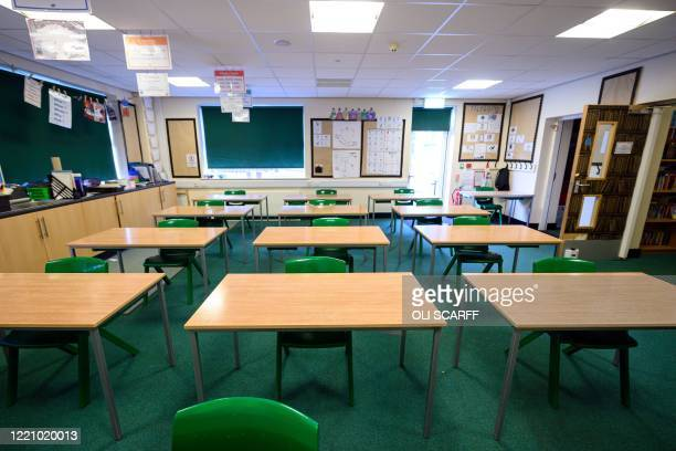 Classroom is set out with socially distanced seating for year 6 pupils but remains empty due to lack of pupils returning in that year group, at...