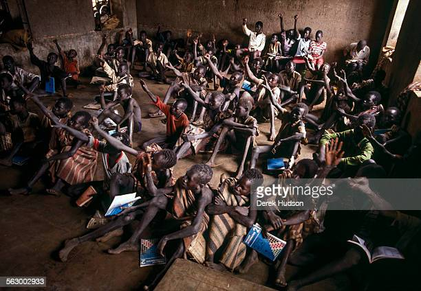 A classroom of refugee children at an abandoned mission near Palotaka South Sudan Two hundred kilometres west of the border with Kenya 3000 Christian...
