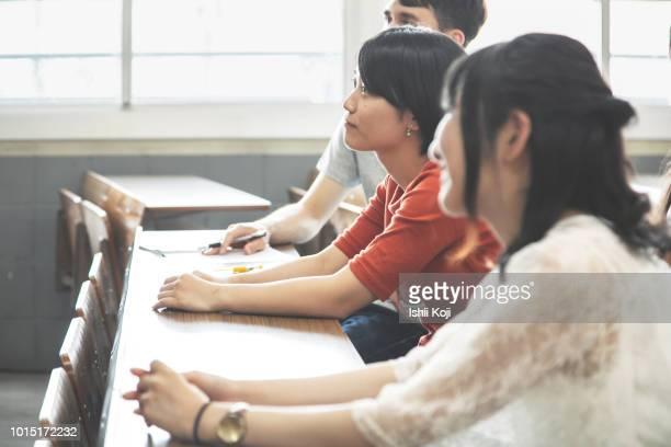 classroom scene of a japanese school - 女子大生 ストックフォトと画像