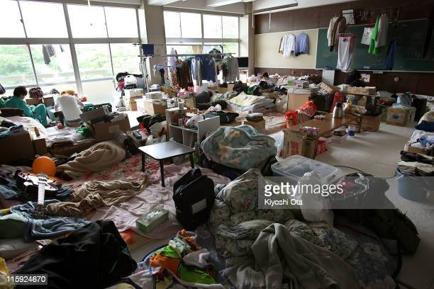 Classroom, shared by seven families and two high school students as a shelter, is seen at Ando Elementary School used as an evacuation center on June...