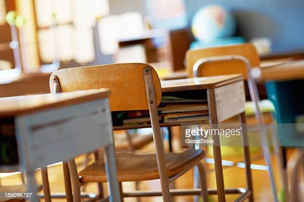 classroom with empty wooden desks - elementary school stock pictures, royalty-free photos & images