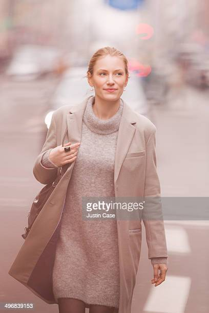classy blond woman walking in the city
