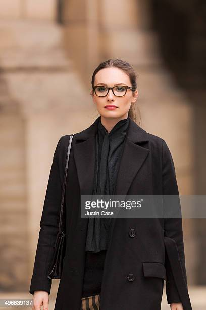 classy brunette woman walking in the street - overcoat stock pictures, royalty-free photos & images