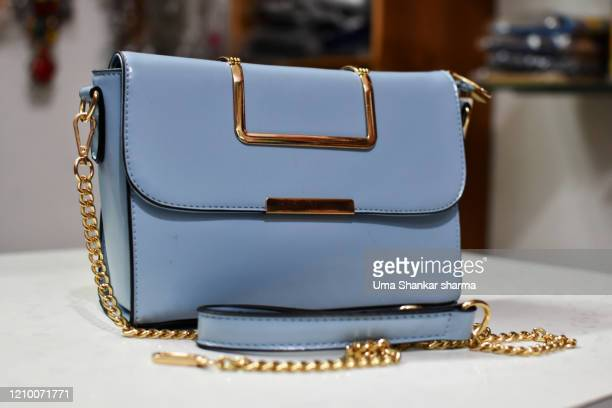 classy hand bag with a sleek finished look - metallic purse stock pictures, royalty-free photos & images
