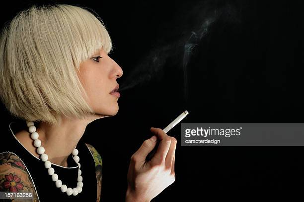 classy smoker - beautiful women smoking cigarettes stock photos and pictures