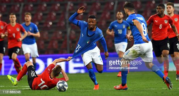 Claud Adjapong of Italy U21 competes for the ball with Sandi Lovric of Austria U21 during the International Friendly match between Italy U21 and...