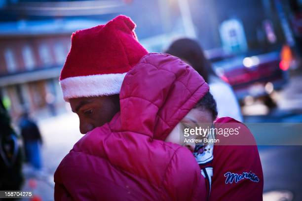 Claud Oliveira holds his son Jeremiah Oliveira at a memorial for those killed in the school shooting at Sandy Hook Elementary School on December 24...
