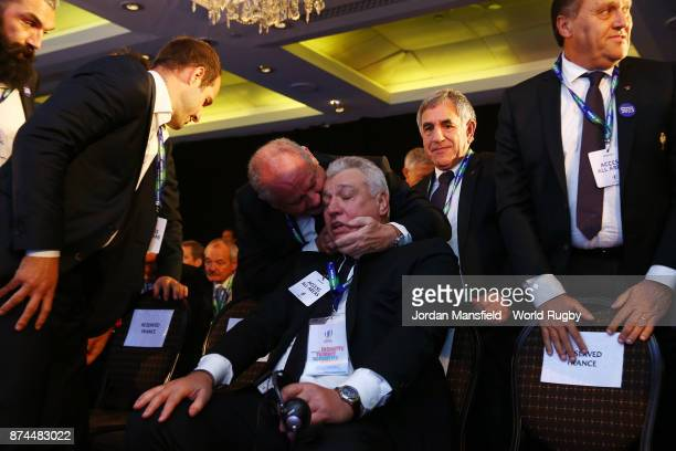 Claude Atcher of the France bid team is congratulated after being annouced as the host nation for the 2023 Rugby World Cup during the Rugby World Cup...