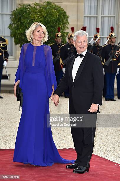 Claude Bartolone and Veronique Bartolone arrive at the Elysee Palace for a State dinner in honor of Queen Elizabeth II hosted by French President...