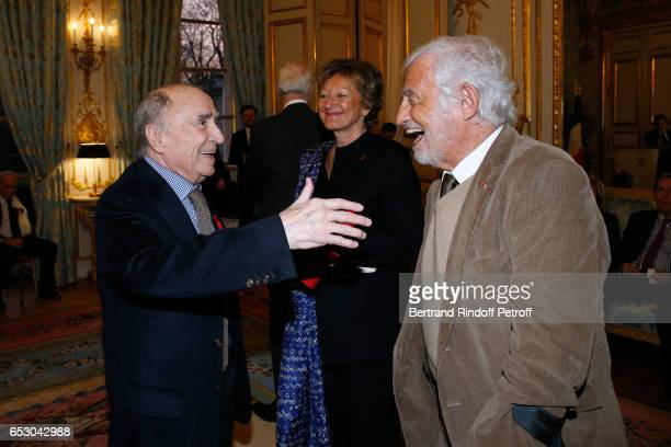 Claude Brasseur and JeanPaul Belmondo attend Claude Brasseur is elevated to the rank of Officier de la Legion d'Honneur at Elysee Palace on March 13...