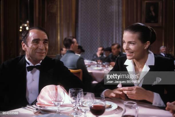 Claude Brasseur et Gudrun Landgrebe sur le tournage du film 'Palace' réalisé par Edouard Molinaro en 1984 France