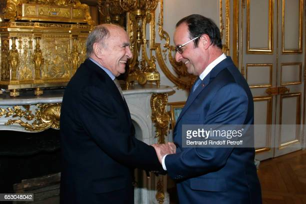 Claude Brasseur is elevated to the rank of Officier de la Legion d'Honneur by the French President Francois Hollande at Elysee Palace on March 13...