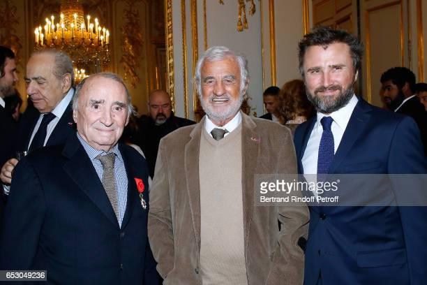 Claude Brasseur JeanPaul Belmondo and Alexandre Brasseur attend Claude Brasseur is elevated to the rank of Officier de la Legion d'Honneur at Elysee...