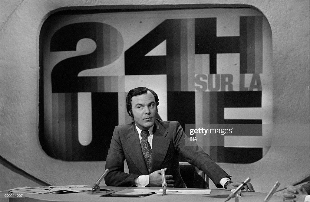 Claude Brovelli presenting the news