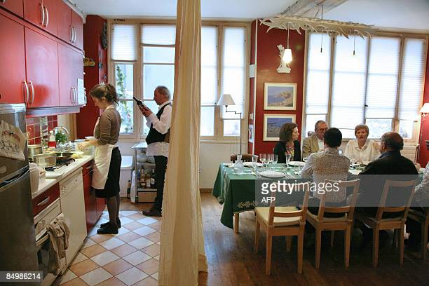 'EXPATS BRING 'UNDERGROUND' RESTAURANTS TO WORLD CAPITAL OF FOOD' Claude Cabri and her companion prepare food for their guests at their home on...