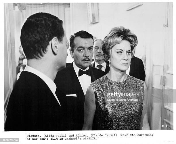 Claude Cerval and Alida Valli leave a film screening in a scene from the film 'Ophelia' 1963