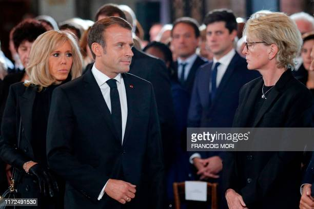 TOPSHOT Claude Chirac daughter of late French President Jacques Chirac looks at French President Emmanuel Macron and his wife Brigitte during a...