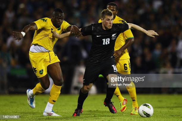 Claude Davis of Jamaica tries to pull Chris Wood of the All Whites back during the international friendly match between the New Zealand All Whites...