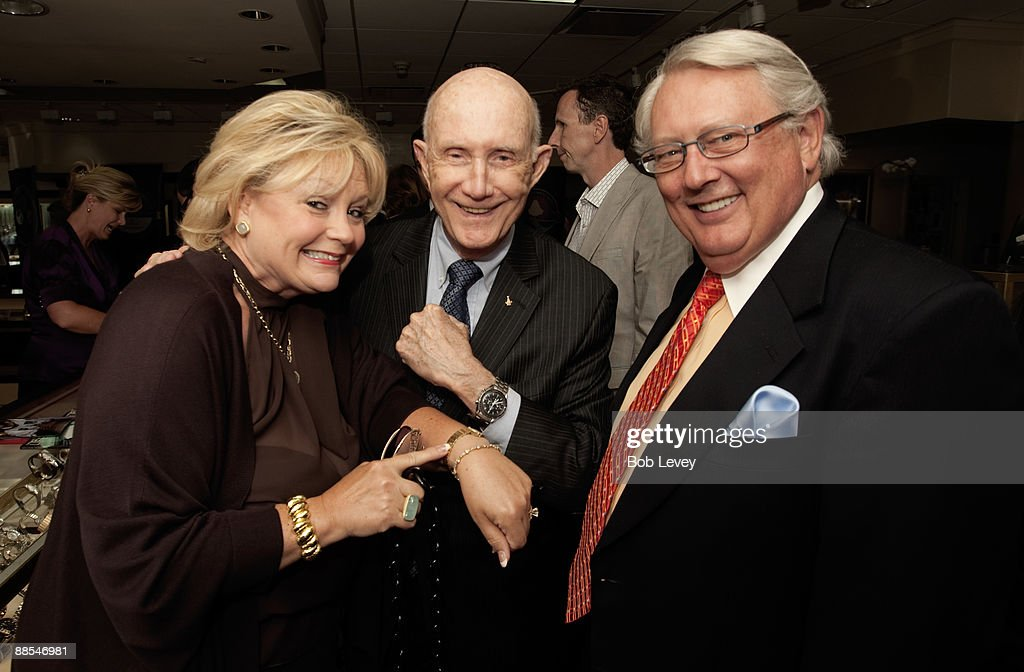 Claude & Debra Wynn compare their Omega watches with Apollo Astronaut General Thomas Stafford as they attend a cocktail reception hosted by Omega at the I.W. Marks Jewelers on June 17, 2009 in Houston, Texas.