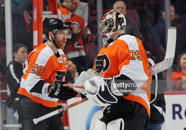 Claude Giroux and Carter Hart of the Philadelphia Flyers celebrate after defeating the Vancouver Canucks 21 on February 4 2019 at the Wells Fargo...