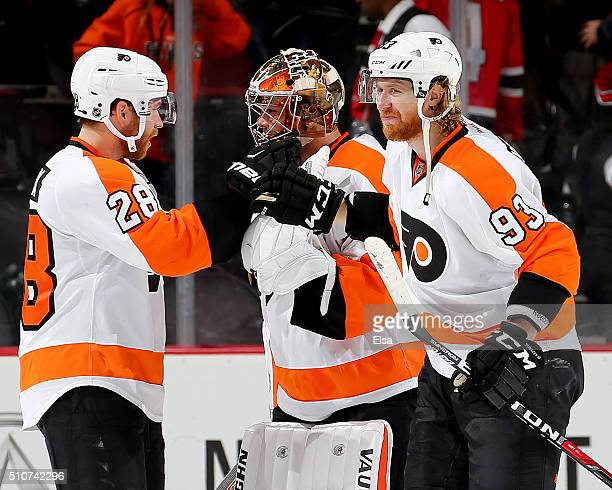 Claude Giroux and Jakub Voracek of the Philadelphia Flyers congratulate Michal Neuvirth after the win over the New Jersey Devils on February 16 2016...