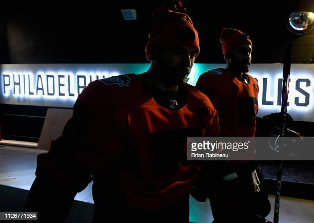 Claude Giroux and Justin Bailey of the Philadelphia Flyers walk down the tunnel to practice for the 2019 Coors Light NHL Stadium Series game against...