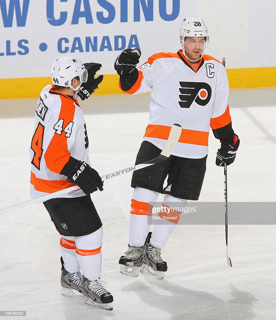 Claude Giroux #28 and Kimmo Timonen #44 of the Philadelphia Flyers celebrate Giroux's goal in the second period against the Buffalo Sabres at First Niagara Center on January 20, 2013 in Buffalo, United States.