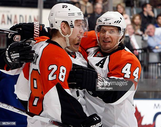 Claude Giroux and Kimmo Timonen of the Philadelphia Flyers celebrate Giroux's goal against the Toronto Maple Leafs during an NHL game at the Air...
