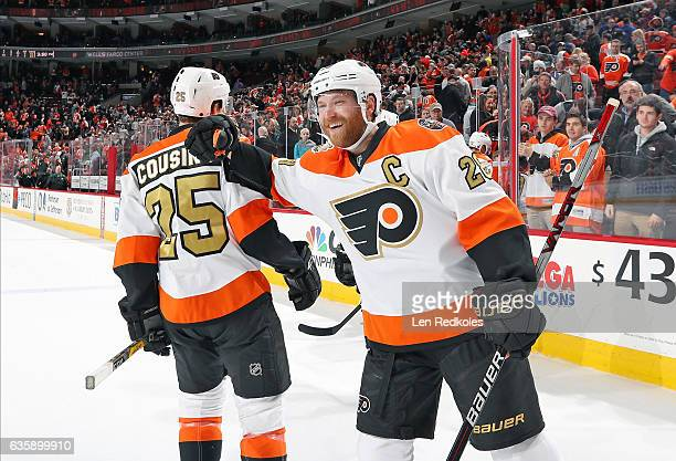Claude Giroux and Nick Cousins of the Philadelphia Flyers celebrate after defeating the Dallas Stars 42 on December 10 2016 at the Wells Fargo Center...