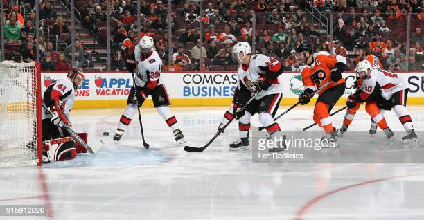 Claude Giroux and Sean Couturier of the Philadelphia Flyers take a shot on goal against Craig Anderson Johnny Oduya JeanGabriel Pageau and Tom Pyatt...