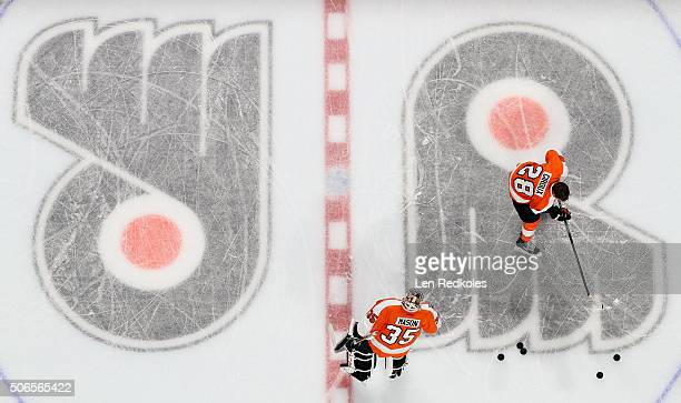 Claude Giroux and Steve Mason of the Philadelphia Flyers warm up prior to their game against the New York Rangers on January 16 2016 at the Wells...