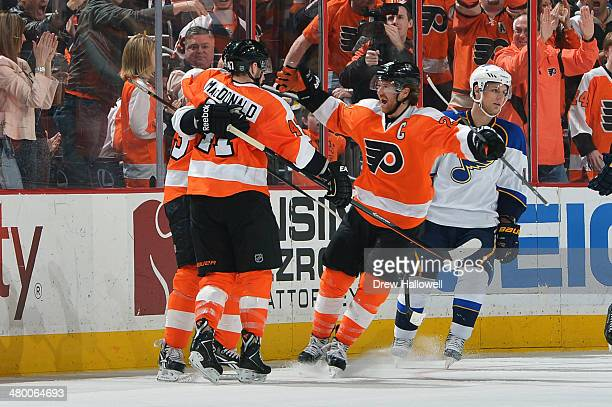 Claude Giroux Andrew MacDonald and Jakub Voracek of the Philadelphia Flyers celebrate a third period goal against the St Louis Blues at the Wells...