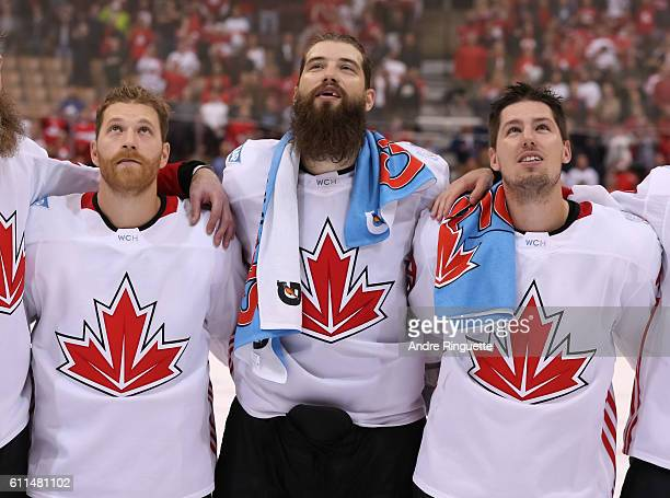 Claude Giroux Brent Burns and Logan Couture of Team Canada enjoy the national anthem after defeating Team Europe 21 during Game Two of the World Cup...