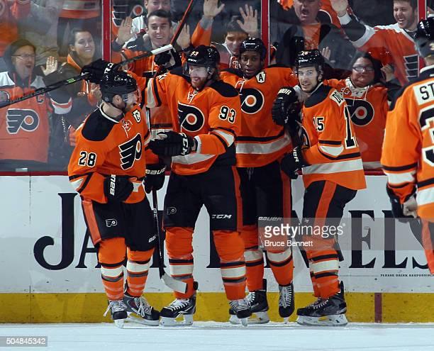 Claude Giroux Jakub Voracek Wayne Simmonds and Michael Del Zotto of the Philadelphia Flyers celebrate Simmond's game tying goal at 1010 of the third...
