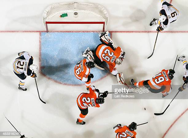 Claude Giroux Luke Schenn Erik Gustafsson Ray Emery and Scott Hartnell of the Philadelphia Flyers scramble to clear the loose puck against Drew...