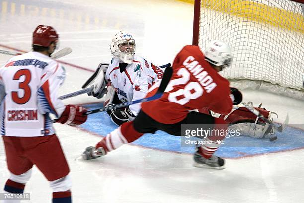 Claude Giroux of Canada scores the first goal of the game against Russian goalkeeper Sergey Bobrovsky in the second period of the Hockey Super Series...
