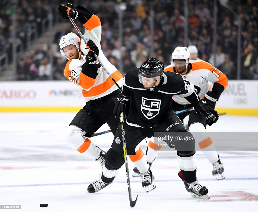 Claude Giroux #28 of the Philadelphia Flyers and Derek Forbort #24 of the Los Angeles Kings collide as they go after the puck during the first period during opening night of the Los Angeles Kings 2017-2018 season at Staples Center on October 5, 2017 in Los Angeles, California.