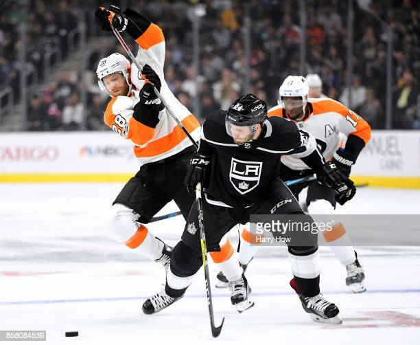 Claude Giroux of the Philadelphia Flyers and Derek Forbort of the Los Angeles Kings collide as they go after the puck during the first period during...
