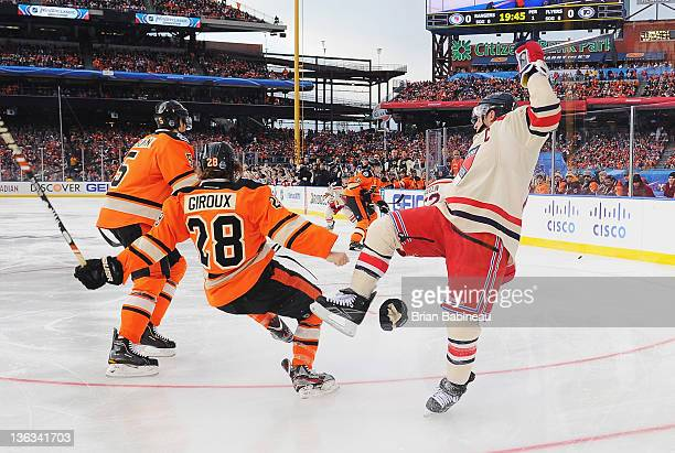 Claude Giroux of the Philadelphia Flyers and Ryan Callahan of the New York Rangers collide during the 2012 Bridgestone NHL Winter Classic at Citizens...
