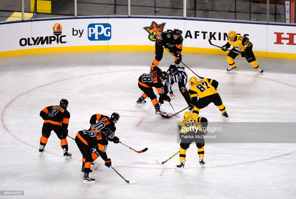 Claude Giroux #28 of the Philadelphia Flyers and Sidney Crosby #87 of the Pittsburgh Penguins take a face-off in the Flyers' zone in the first period of the 2017 Coors Light NHL Stadium Series at Heinz Field on February 25, 2017 in Pittsburgh, Pennsylvania.