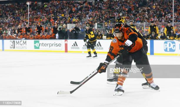 Claude Giroux of the Philadelphia Flyers battles against Evgeni Malkin of the Pittsburgh Penguins at the 2019 Coors Light NHL Stadium Series on...