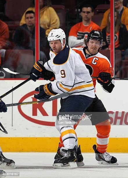 Claude Giroux of the Philadelphia Flyers battles against Steve Ott of the Buffalo Sabres on November 21 2013 at the Wells Fargo Center in...