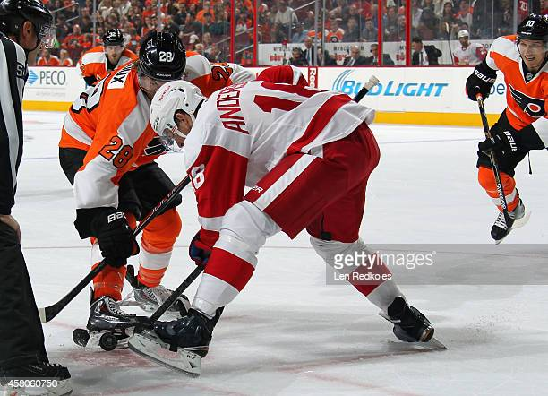 Claude Giroux of the Philadelphia Flyers battles for the puck on a faceoff against Joakim Andersson of the Detroit Red Wings on October 25 2014 at...