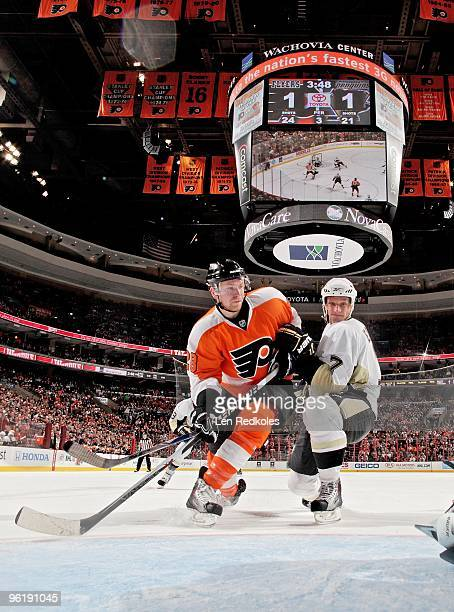 Claude Giroux of the Philadelphia Flyers battles in the crease against Mark Eaton of the Pittsburgh Penguins on January 24 2010 at the Wachovia...