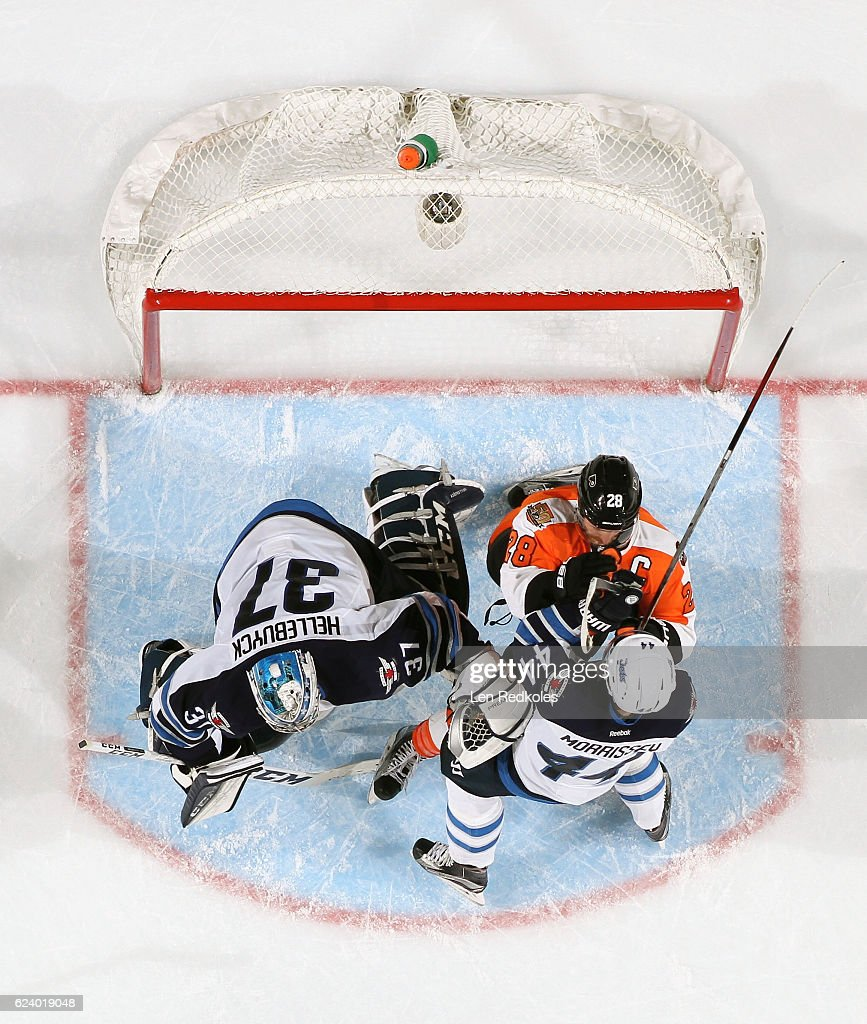 Claude Giroux #28 of the Philadelphia Flyers battles with Josh Morrissey #44 of the Winnipeg Jets in the crease of Connor Hellebuyck #37 on November 17, 2016 at the Wells Fargo Center in Philadelphia, Pennsylvania. The Flyers went on to defeat the Jets 5-2.